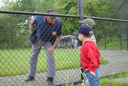 MBUA umpire with young fans